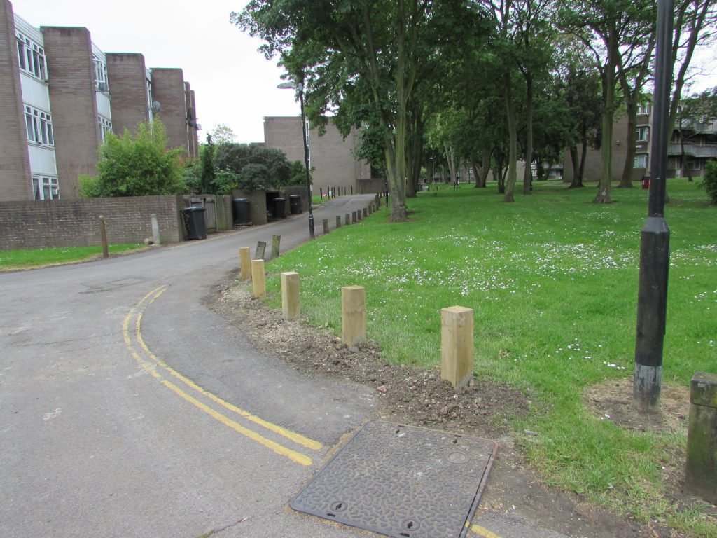 New wooden bollards on the service road